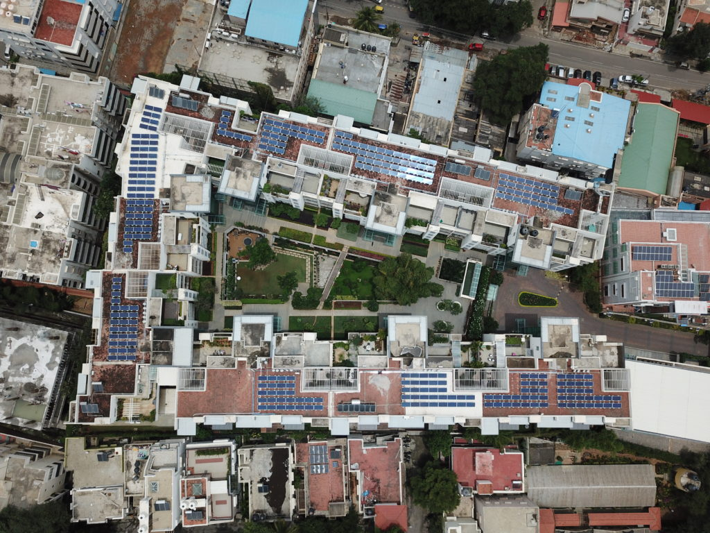 drone view of solar panels on rooftop